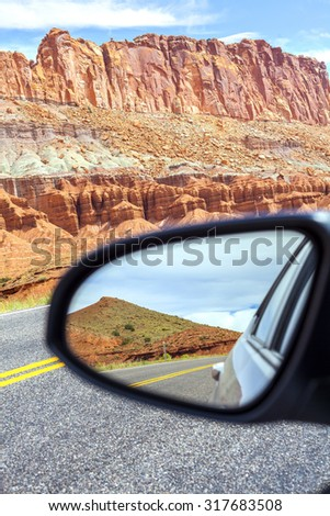 Road in a mirror, Capitol Reef National Park, USA. - stock photo