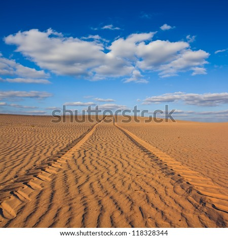 road in a sand desert