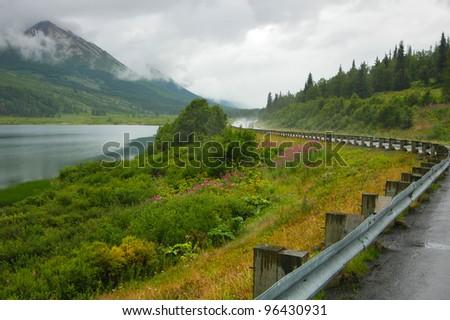 Road in Alaska A pretty curved road in Alaska, USA. - stock photo