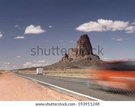 Road in Arizona near El Capitan, also called Agathla by the Navajo people  - stock photo