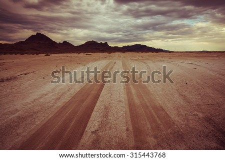 road in Bonneville salt desert. Dramatic view. Utah. - stock photo