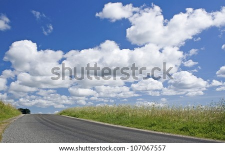 Road, in countryside with sky.