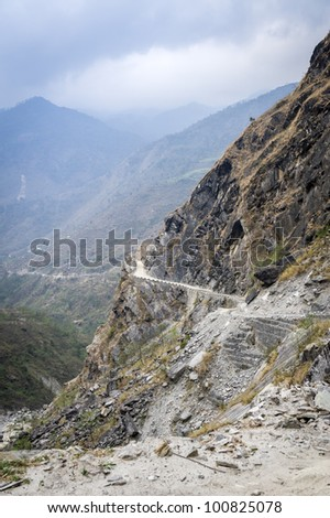 Road in Himalaya mountains during misty day, Nepal - stock photo