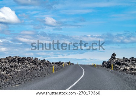 Road in Iceland on a clear sunny day - stock photo
