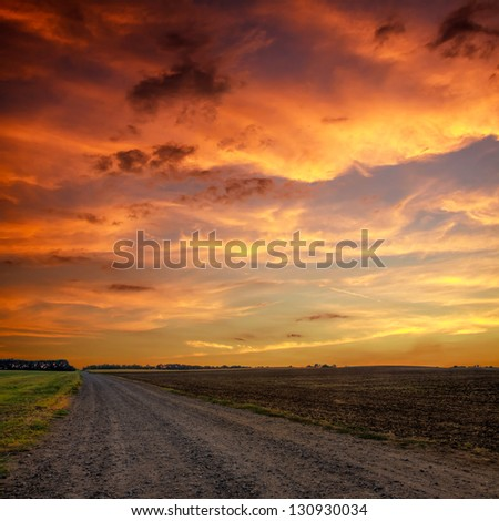 Road in meadows and beautiful sunset.this photo made by HDR technic - stock photo