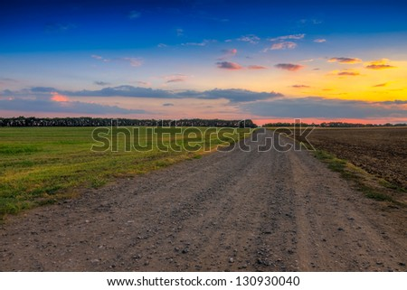 Road in meadows and beautiful sunset.this photo made by HDR technic