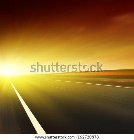 Road in motion blur at dusk. - stock photo
