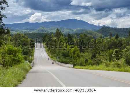 Road in mountain and blue sky background  - stock photo