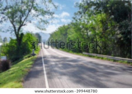 road in mountains. blur background of road - stock photo