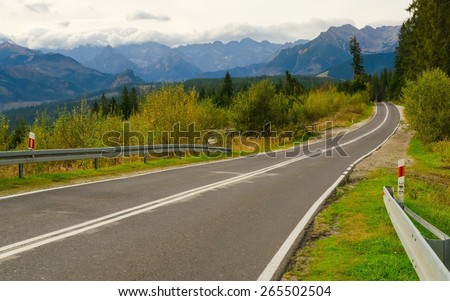 Road in mountains. Winding route leads to the high summits in Tatra mountains in Poland. - stock photo