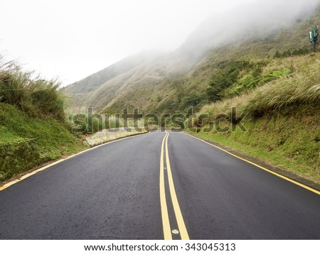 Road in national yangming mountain park in fog weather,Taipei,Taiwan