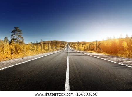 road in north mountains in autumn time  - stock photo