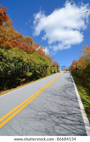 Road in the Blue Ridge Mountains during fall season from Brasstown Bald, the highest elevation in the state of Georgia, USA. - stock photo