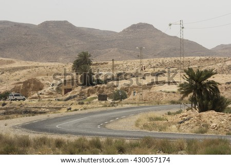 Road in the desert of Sahara, landscape of the South of Tunisia - stock photo