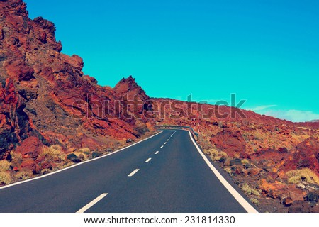 road in the frozen lava in the crater of a volcano Teide on a sunny day