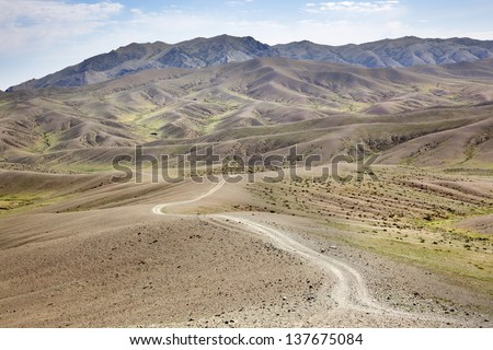 Road in the middle of the Gobi Desert in Mongolia - stock photo