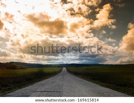 road in the mountains at dusk - stock photo