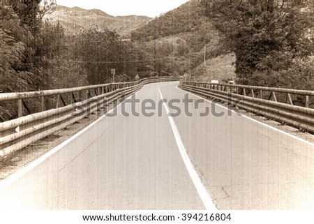 road in the mountains of Tuscany, Italy. Old style, sepia - stock photo