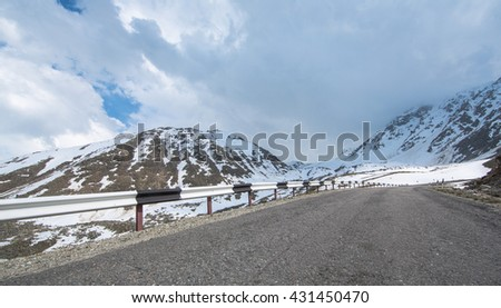 road in the snowy mountains mountains