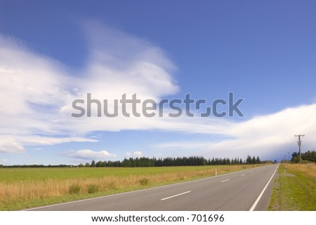 Road in the South Island of New Zealand, near Oxford in North Canterbury, with dramatic sky.