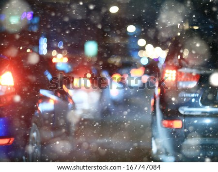 road in winter night, traffic jams, snow city diffuse - stock photo