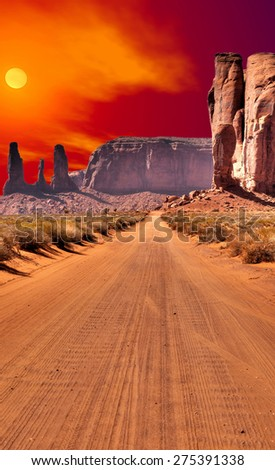 Road into Monument Valley Arizona with evening sunset skies - stock photo