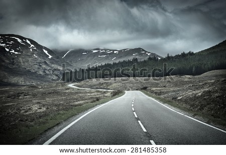 Road into Mountain Range, Scotland, UK - stock photo