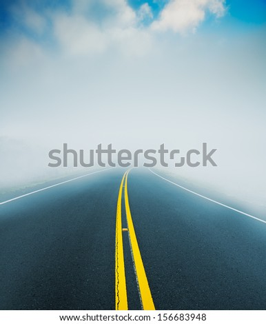 Road into the Fog, Mysterious Landscape - stock photo