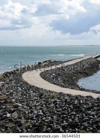 Road into the sea - stock photo