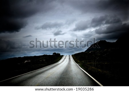 road leading into a beautiful landscape in the north of Norway - stock photo