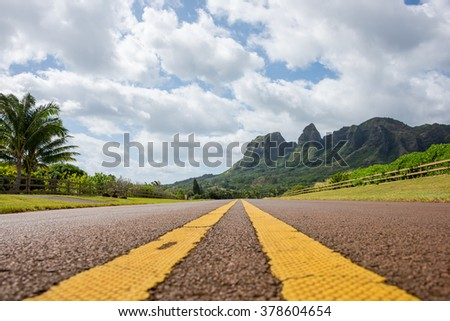 Road leading to Kalalea mountain on the island of Kauai, Hawaii.  This is the location where King Kong & Raider of the Lost Ark was filmed. - stock photo