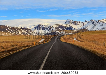 Road leading to snow covered mountains, Iceland