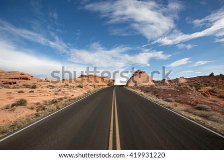 road leading uphill in nevada  - stock photo