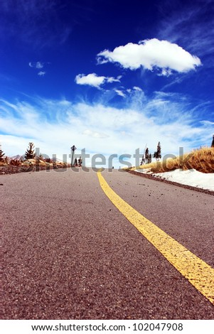 Road leads to blue skies