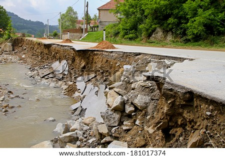 Road leftovers after natural distruction river flooding - stock photo