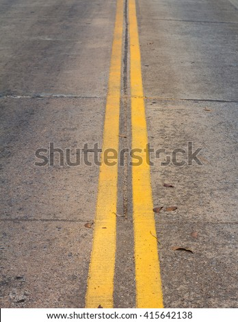 Road Marking - Double Yellow Lines on Concrete