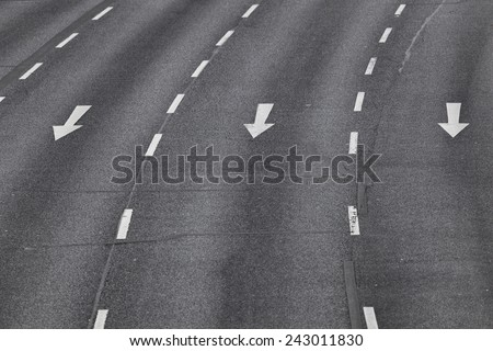 Road marking, three lanes with arrow signs - stock photo