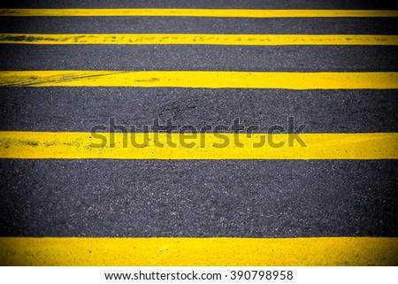 Road Marking Yellow Lines on asphalt - stock photo