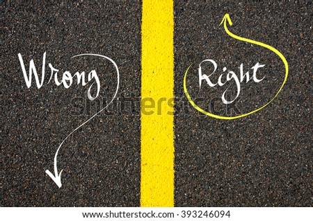 Road marking yellow paint dividing line between Right and Wrong words going in different directions, Find Your Own Way concept - stock photo