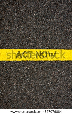 Road marking yellow paint dividing line with words ACT NOW, concept image