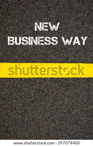 Road marking yellow paint dividing line with words NEW BUSINESS WAY, concept image