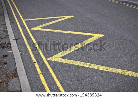 Road markings indicating no stopping or parking - stock photo