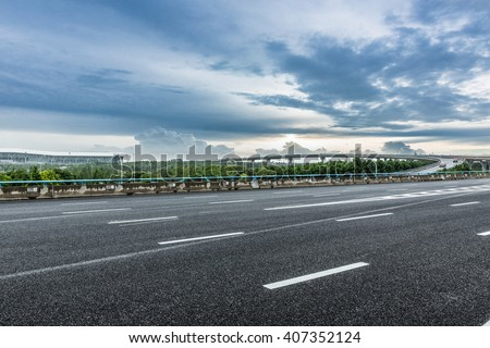 road near by the airport under the cloudy sky - stock photo