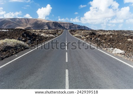 Road near Orzola, Lanzarote, Canary Islands, Spain. - stock photo