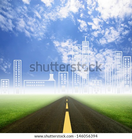 road on grass field to city with sky