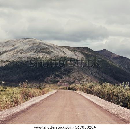 Road on polar tundra.Instagram filter. - stock photo