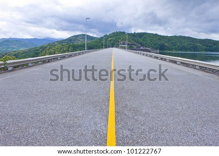 Road on the ridge of Si-ri-kit dam,Utaradit,Thailand