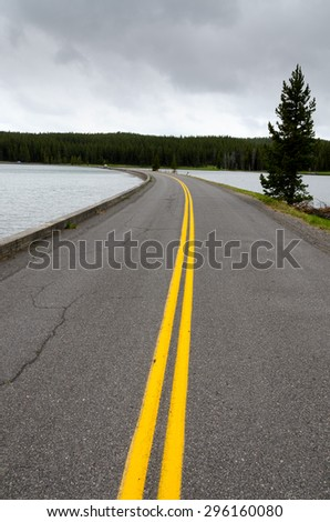 road on the Yellowstone lake in Wyoming