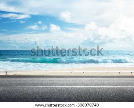 road on tropical beach - stock photo