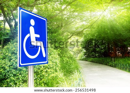 Road park, handicapped access and logo. - stock photo